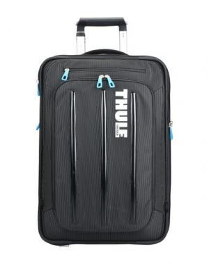 Чемодан/сумка на колесиках THULE®. Цвет: черный