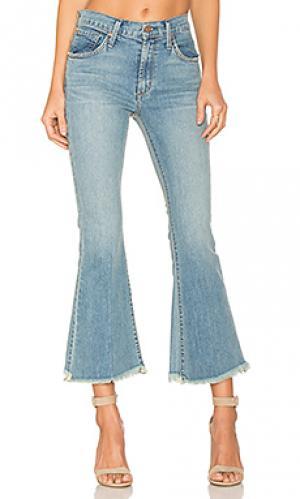 Расклешенные джинсы с потрепанным низом kiki James Jeans. Цвет: none