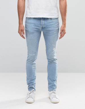 River Island Светло-голубые джинсы скинни с потертостями. Цвет: синий