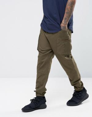 ASOS Зауженные спортивные штаны с карманами-карго. Цвет: зеленый