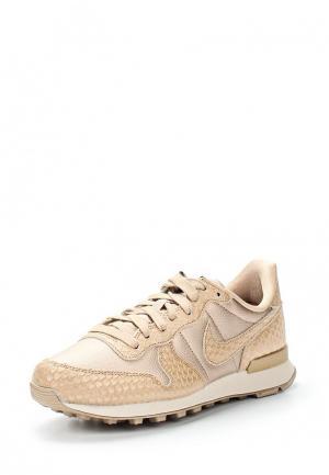 Кроссовки Nike. Цвет: золотой