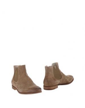 Полусапоги и высокие ботинки VAGABOND. Цвет: песочный