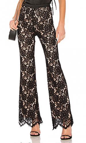 Расклешенные кружевные брюки que bonita X by NBD. Цвет: черный