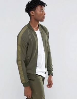 Adidas Originals Зеленая спортивная куртка Brand Pack AY9304. Цвет: зеленый