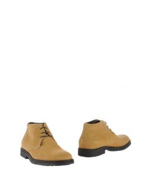 Полусапоги и высокие ботинки FABRIZIO MANCINI. Цвет: охра