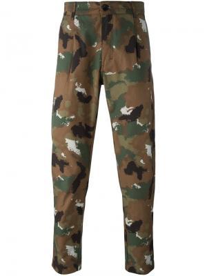 Камуфляжные брюки Études. Цвет: многоцветный