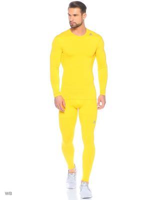 Тайтсы Adidas. Цвет: желтый