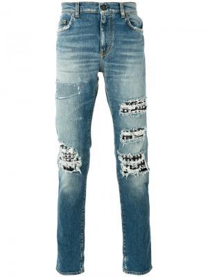 Рваные джинсы с заклепками Saint Laurent. Цвет: синий