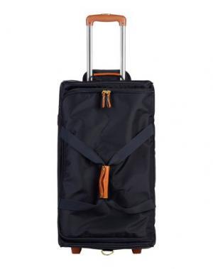 Чемодан/сумка на колесиках BRIC'S. Цвет: темно-синий