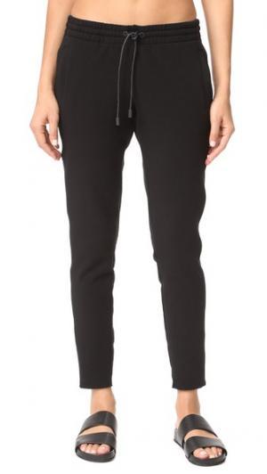 Спортивные брюки Storm ALALA. Цвет: голубой