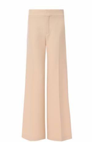 Шерстяные расклешенные брюки Chloé. Цвет: светло-бежевый