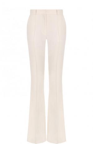 Однотонные расклешенные брюки со стрелками Victoria Beckham. Цвет: белый