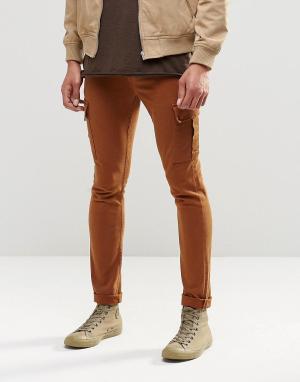 ASOS Супероблегающие джинсы цвета ржавчины с карманами‑карго. Цвет: коричневый