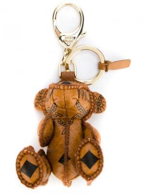 Брелок в виде медведя MCM. Цвет: коричневый