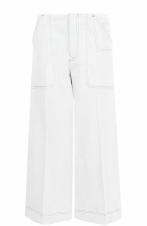 Укороченные расклешенные джинсы со стрелками Acne Studios. Цвет: белый