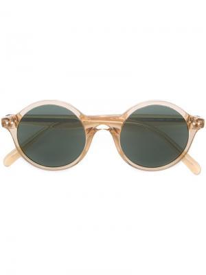 Прозрачные солнцезащитные очки в круглой оправе Céline Eyewear. Цвет: жёлтый и оранжевый