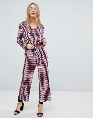 Honey Punch Комбинируемые свободные брюки в полоску. Цвет: мульти