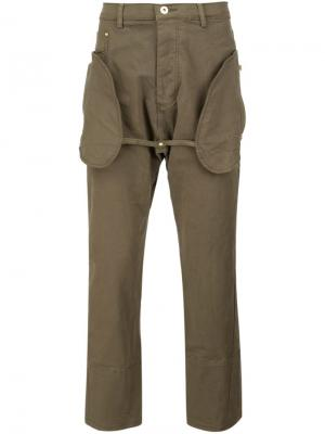 Брюки с овальными карманами Mr. Completely. Цвет: зелёный
