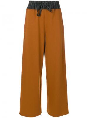 Расклешенные брюки Mm6 Maison Margiela. Цвет: коричневый