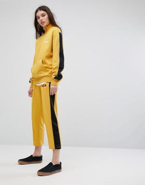 Ellesse Спортивные штаны с полосками. Цвет: желтый