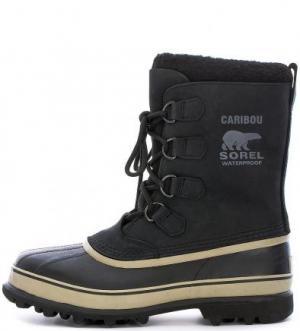 Высокие непромокаемые ботинки из нубука и резины Sorel. Цвет: черный