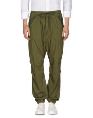 Повседневные брюки NLST. Цвет: зеленый-милитари