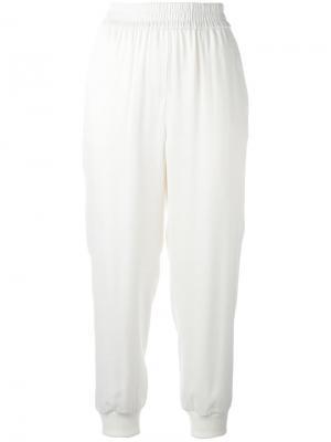Эластичные брюки DKNY. Цвет: белый