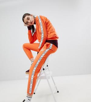 Puma Оранжевые спортивные штаны эксклюзивно для ASOS. Цвет: оранжевый