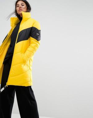 Puffa Длинная оверсайз-куртка с контрастной вставкой. Цвет: желтый
