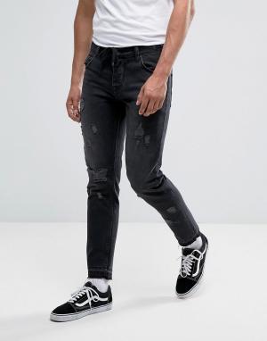 ASOS Выбеленные черные узкие джинсы с рваной отделкой и затягивающимся шнур. Цвет: черный