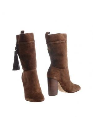 Полусапоги и высокие ботинки VINCE CAMUTO. Цвет: коричневый