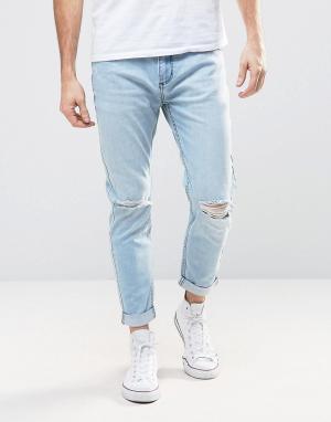 Rollas Узкие эластичные джинсы с дырками на коленях Rollies. Цвет: синий