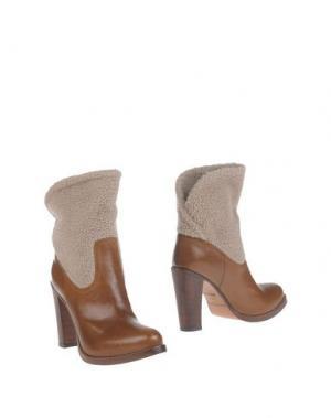 Полусапоги и высокие ботинки SARTORE. Цвет: коричневый