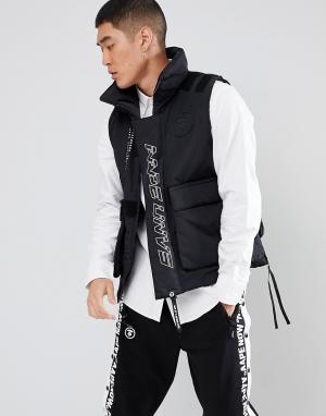 AAPE BY A BATHING APE Дутый жилет со светоотражающим камуфляжным принтом. Цвет: черный