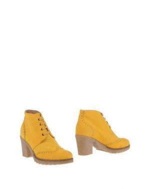 Полусапоги и высокие ботинки GIONATA. Цвет: желтый