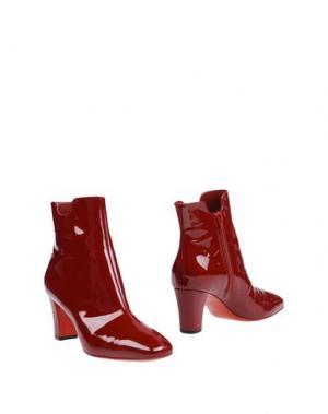 Полусапоги и высокие ботинки CHRISTIAN LOUBOUTIN. Цвет: красный