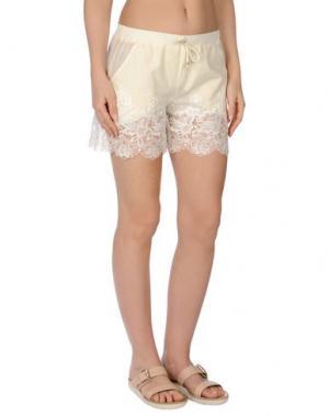 Пляжные брюки и шорты MISS NAORY. Цвет: слоновая кость
