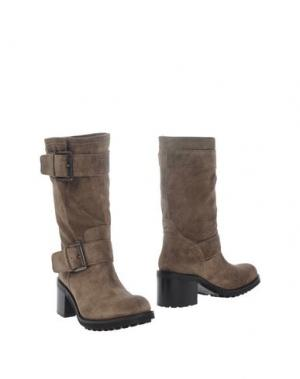 Полусапоги и высокие ботинки FABIO RUSCONI. Цвет: хаки