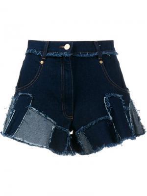 Джинсовые шорты лоскутного кроя Natasha Zinko. Цвет: синий