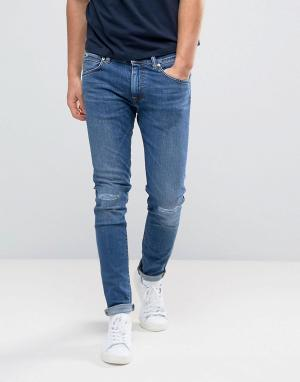 Edwin Узкие заниженные джинсы с рваными коленями ED-85. Цвет: синий