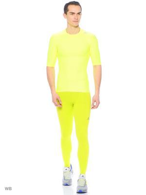 Тайтсы Adidas. Цвет: салатовый