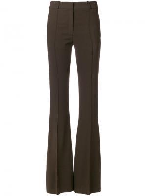 Строгие расклешенные брюки Victoria Beckham. Цвет: зелёный