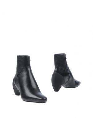 Полусапоги и высокие ботинки COURRÈGES. Цвет: черный