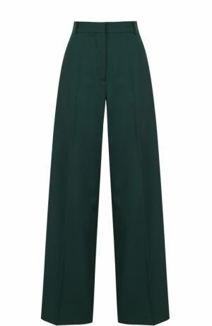 Шерстяные расклешенные брюки с контрастными лампасами Racil. Цвет: зеленый