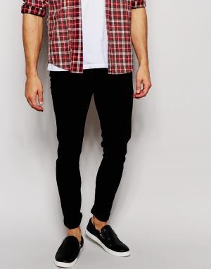 ASOS Ультразауженные джинсы. Цвет: черный