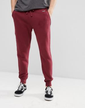 Hollister Бордовые флисовые джоггеры с манжетами и логотипом. Цвет: красный