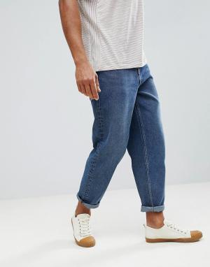 ASOS Темные расклешенные джинсы. Цвет: синий