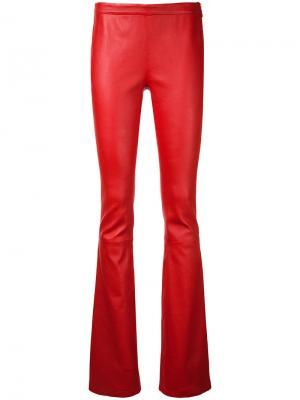Расклешенные брюки Pierre Balmain. Цвет: красный