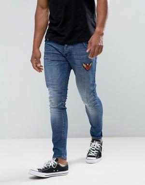 Juice Эластичные джинсы скинни с нашивками. Цвет: синий