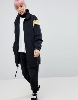 Adidas Originals Черная куртка с золотистыми вставками. Цвет: черный